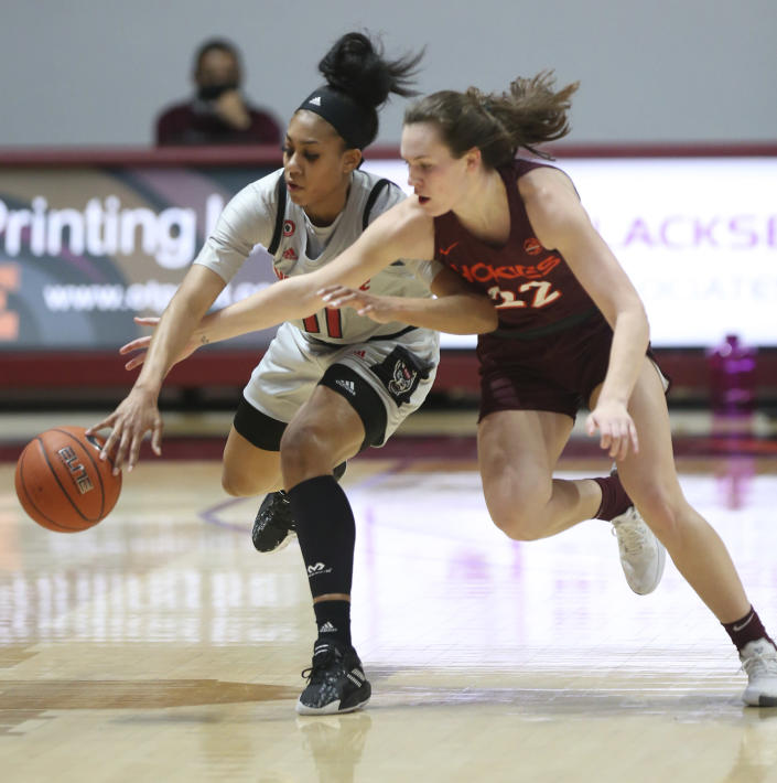 North Carolina State's Jakia Brown-Turner (11) and Virginia Tech's Cayla King (22) compete for a rebound during the first half of an NCAA college basketball game in Blacksburg, Va., Thursday, Jan. 28, 2021. (Matt Gentry/The Roanoke Times via AP, Pool)
