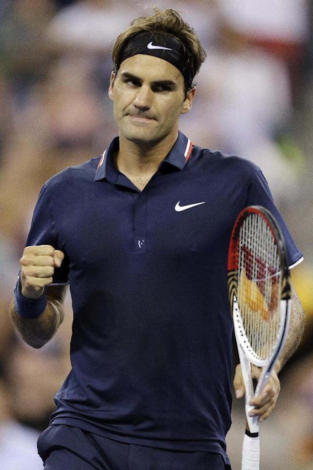 Roger Federer, of Switzerland, reacts during a quarterfinals match against Tomas Berdych, of Czech Republic, at the U.S. Open tennis tournament, Wednesday, Sept. 5, 2012, in New York. (AP Photo/Darron Cummings)