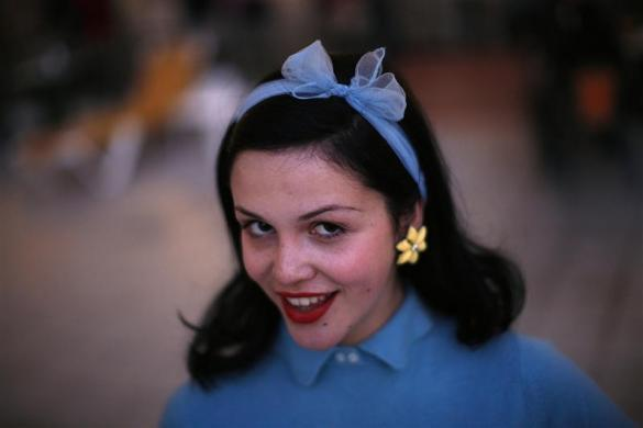 A woman dressed in fifties-style outfit poses for a photo during the 18th Rockin' Race Jamboree International Festival in Torremolinos, near Malaga, southern Spain February 4, 2012.