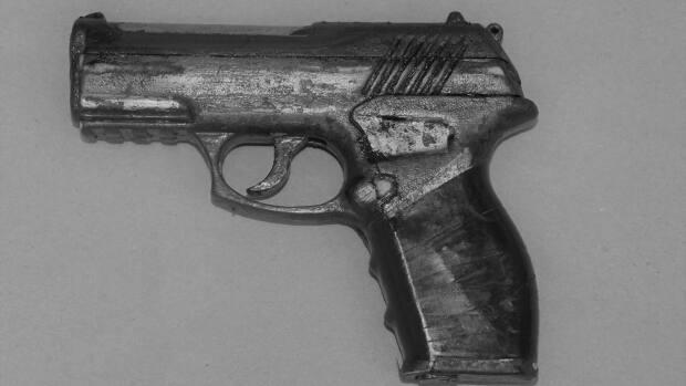 The Alberta Serious Incident Response Team says a replica handgun, pictured above, was recovered from the scene.  (Alberta Serious Incident Response Team  - image credit)