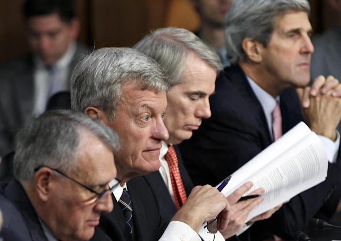 FILE - This Oct. 26, 2011 file photo shows Supercommittee members, from left, Sen. Jon Kyl, R-Ariz., Sen. Max Baucus, D-Mont., Sen. Rob Portman, R-Ohio, and Sen. John Kerry, D-Mass., take part in a hearing on Capitol Hill in Washington. Just about everybody agrees Washington is a mess. But who can fix it? After two years of strife and stalemate between Obama and congressional Republicans, more voters trust Romney than Obama to break through the gridlock, an Associated Press-GfK poll shows. Romney's message _ a vote for Obama is a vote for more impasse _ seems to be getting through (AP Photo/J. Scott Applewhite, File)