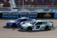 Kyle Larson (5) and Chase Elliott (9) race through Turn 4 during a NASCAR Cup Series auto race at Phoenix Raceway, Sunday, March 14, 2021, in Avondale, Ariz. (AP Photo/Ralph Freso)