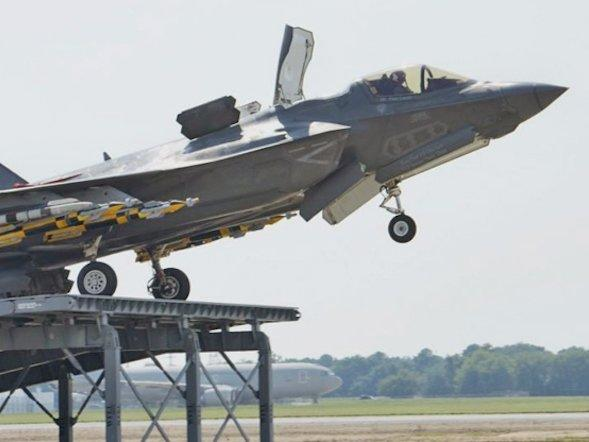 watch an f 35 perform a ski jump takeoff for use on britain s new