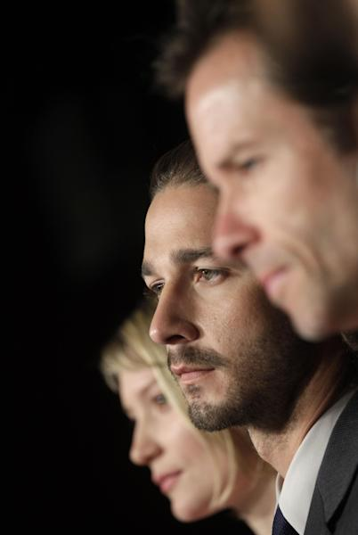 from left, actors Mia Wasikowska, Shia LaBeouf and Guy Pearce listen to questions during a press conference for Lawless at the 65th international film festival, in Cannes, southern France, Saturday, May 19, 2012. (AP Photo/Virginia Mayo)