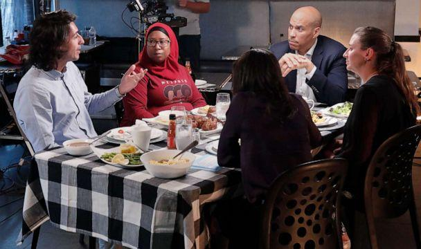 PHOTO: Bijan Roghanchi,left asks a question during a dinner with other voters and Democratic presidential candidate Cory Booker at a restaurant in Newark, N.J. (Lou Rocco/Walt Disney Television)