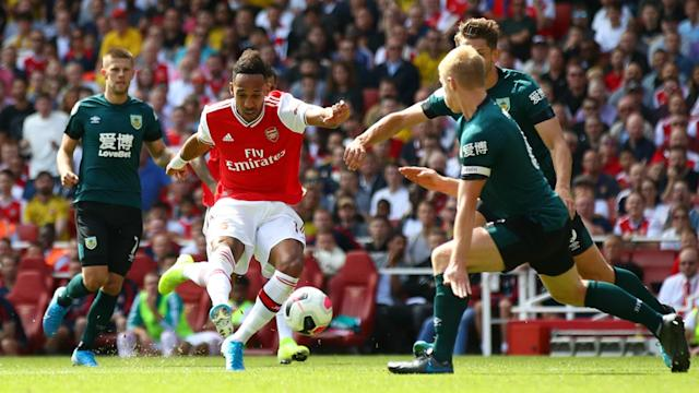 Pierre-Emerick Aubameyang and Alexandre Lacazette scored either side of Ashley Barnes' goal to give Arsenal a hard-earned home win.