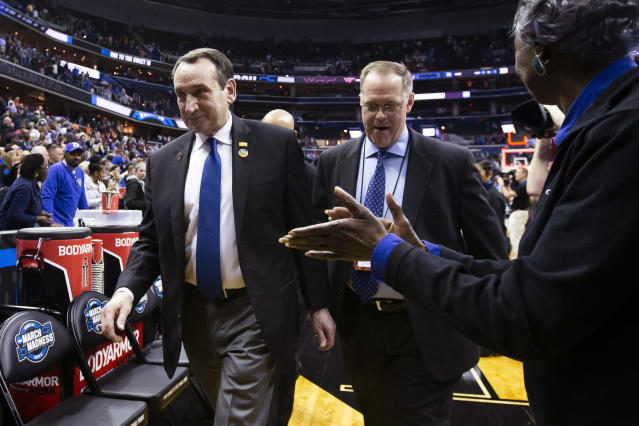 Duke coach Mike Krzyzewski, left, heads off the court after the team's NCAA men's college basketball tournament East Region semifinal against Virginia Tech in Washington, Friday, March 29, 2019. Duke won 75-73. (AP Photo/Alex Brandon)