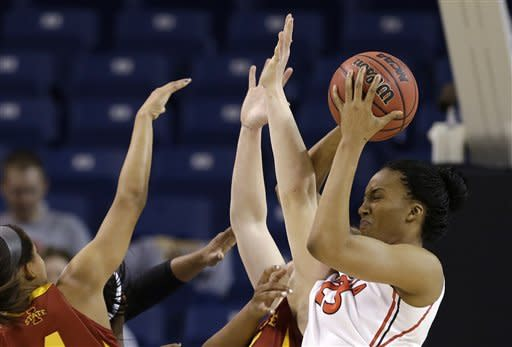 Georgia's Tamika Willis pulls down a rebound in a crowd against Iowa States in the first half of a second-round game in the women's NCAA college basketball tournament in Spokane, Wash., Monday, March 25, 2013. (AP Photo/Elaine Thompson)