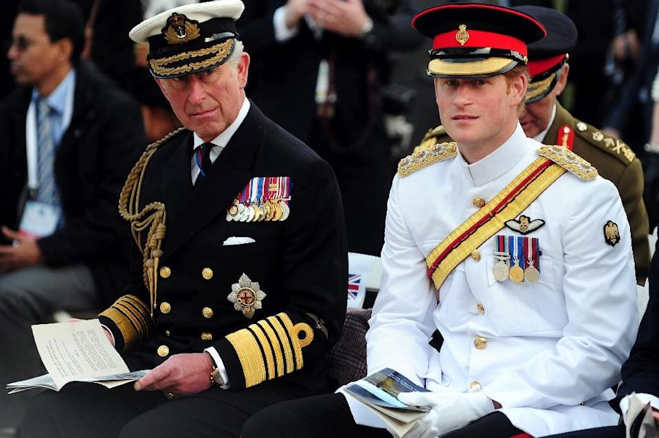 Britain's Prince Charles, the Prince of Wales (R) and Prince Harry (L) look on during a French memorial service marking the 100th anniversary of the start of the Battle of Gallipoli on April 24, 2015 in Canakkale (AFP Photo/Ozan Kose)