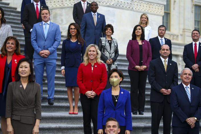 Rep. Marjorie Taylor Greene (R-GA) (Center, in red) and other newly elected Republican House members meet on the East Front of the US Capitol for a group photo. (Photo by Tasos Katopodis/Getty Images)