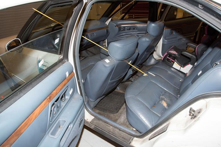 The trajectory of where a bullet became lodged next to a child's chair in the rear seat of the car.