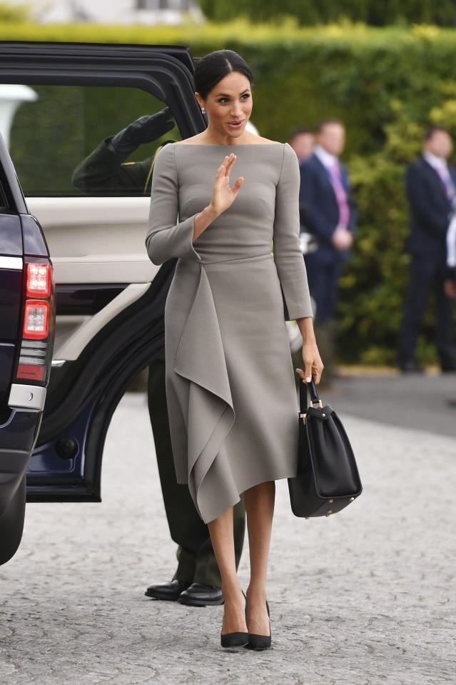 The Duchess of Sussex opted for a neutral palette with her Roland Mouret dress and black Fendi bag. (Photo: Joe Giddens/PA via AP)