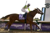 Florent Geroux rides Monomoy Girl to win the Breeders' Cup Distaff horse race at Keeneland Race Course, in Lexington, Ky., Saturday, Nov. 7, 2020. (AP Photo/Michael Conroy)
