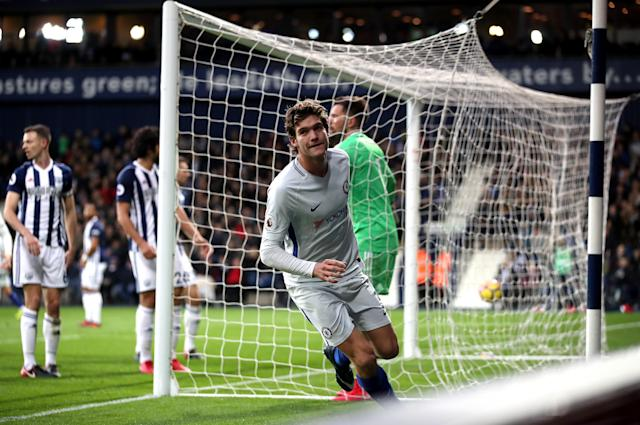 Chelsea's Marcos Alonso celebrates scoring Chelsea's third goal against woeful West Brom