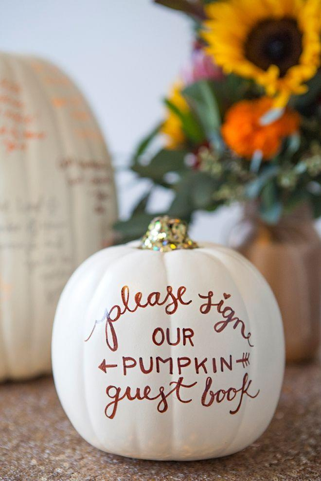 """<p>This genius approach to pumpkin decorating is a keeper. Coat your pumpkin in white, give your party guests markers, and ask them to sign their names or write little messages as a memento. (PS: This is a great idea for <a href=""""https://www.womansday.com/home/decorating/g269/easy-fall-centerpiece-ideas-124043/"""" rel=""""nofollow noopener"""" target=""""_blank"""" data-ylk=""""slk:fall weddings"""" class=""""link rapid-noclick-resp"""">fall weddings</a>, too!) </p><p><em><strong>Get the tutorial from <a href=""""http://somethingturquoise.com/2014/10/31/diy-faux-pumpkin-guest-book/"""" rel=""""nofollow noopener"""" target=""""_blank"""" data-ylk=""""slk:Something Turquoise"""" class=""""link rapid-noclick-resp"""">Something Turquoise</a>.</strong></em><br></p>"""