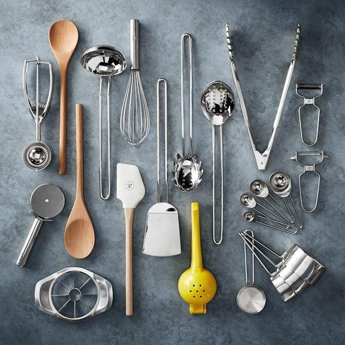 "<h2>Utensils </h2> <br>""Utensils are like the paintbrushes for your culinary masterpieces, and having items such as tongs, spatulas, wooden spoons, and measuring cups and spoons are great additions,"" Tubbs says. <br><br><strong>Open Kitchen by Williams Sonoma</strong> Essential 17-Piece Tool Set, $, available at <a href=""https://go.skimresources.com/?id=30283X879131&url=https%3A%2F%2Fwww.williams-sonoma.com%2Fproducts%2Fopen-kitchen-essential-17-piece-tool-set%2F"" rel=""nofollow noopener"" target=""_blank"" data-ylk=""slk:Williams-Sonoma"" class=""link rapid-noclick-resp"">Williams-Sonoma</a><br>"