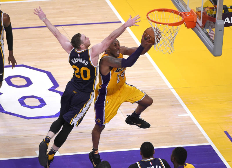Los Angeles Lakers forward Kobe Bryant, right, shoots as Utah Jazz forward Gordon Hayward defends during the second half of an NBA basketball game, Wednesday, April 13, 2016, in Los Angeles. Bryant scored 60 points in his final NBA game as the Lakers won 101-96. (AP Photo/Mark J. Terrill)