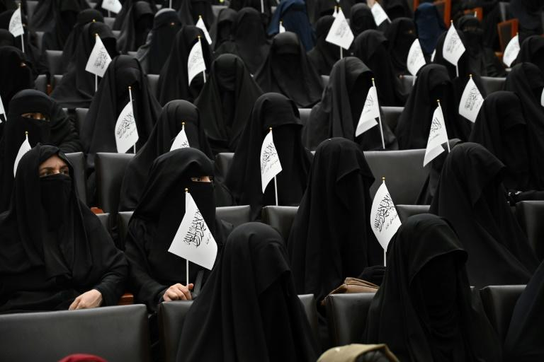 Around 300 women gathered in a lecture hall to hear speakers extol the virtues of Taliban rule, with dozens staging a rally on Kabul's streets afterwards (AFP/Aamir QURESHI)