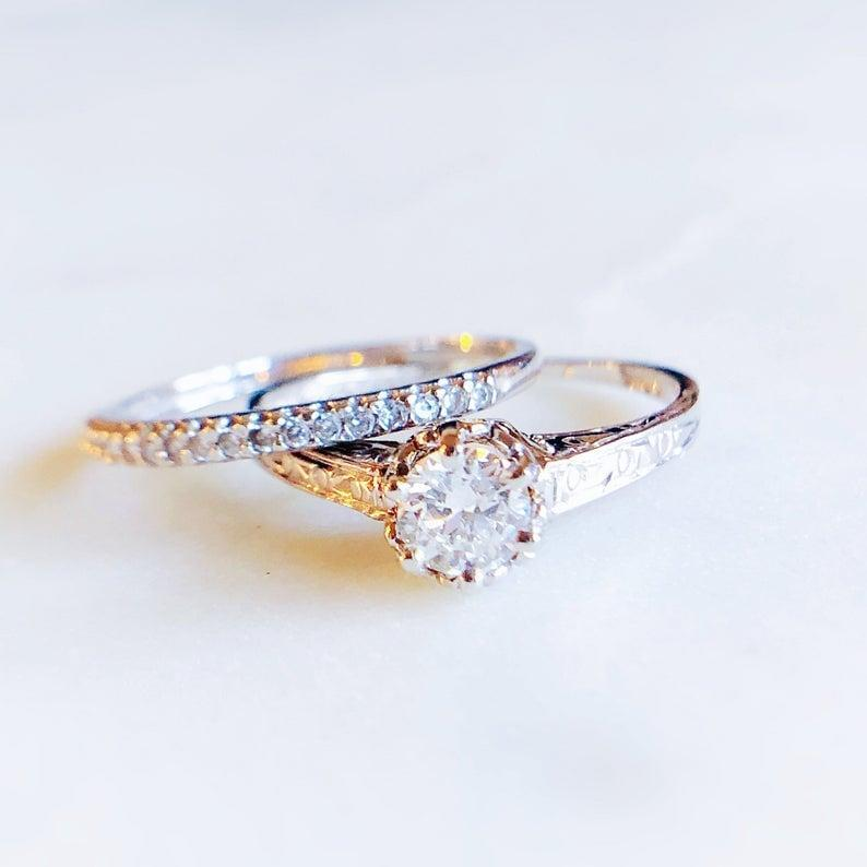 <p>The unique band on this <span>Khorasan Vintage 14K White Gold and Diamond Engagement Ring</span> ($1,298) features a center stone with round diamonds.</p>