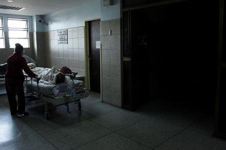 A patient waits in the corridors of the Central Hospital of San Cristobal for the power to be restored in order to use elevators, during a blackout in San Cristobal, Venezuela March 14, 2018. Picture taken March 14, 2018. REUTERS/Carlos Eduardo Ramirez