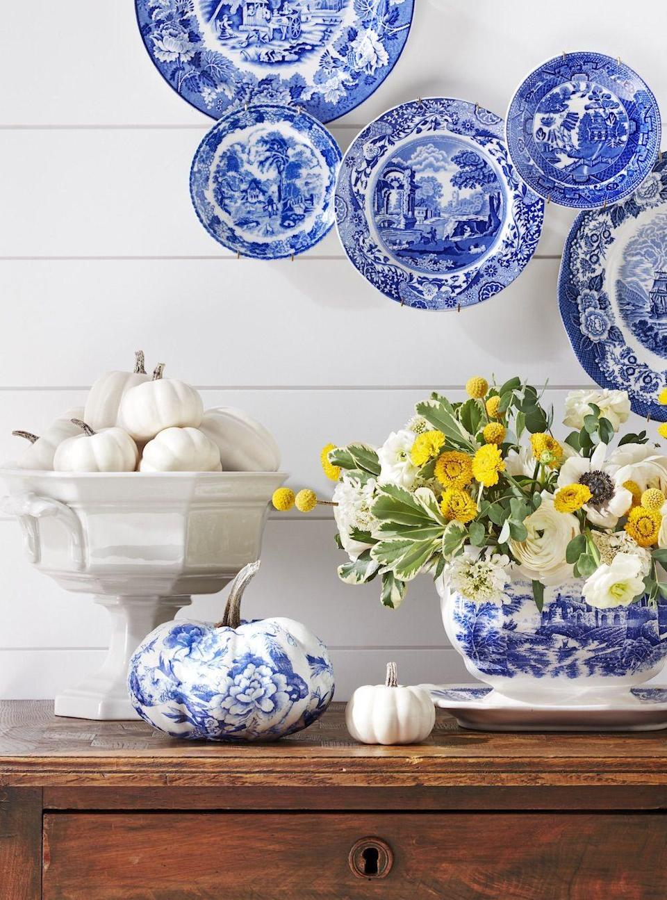 """<p>Update plain pumpkins by decoupaging them with paper napkins. This blue and white transferware print version is a country classic.</p><p><a class=""""link rapid-noclick-resp"""" href=""""https://www.amazon.com/Decorative-Napkins-Cocktail-Beverage-Birthday/dp/B07PQHYM6B/ref=psdc_15347411_t2_B07DT9B637?tag=syn-yahoo-20&ascsubtag=%5Bartid%7C10050.g.3739%5Bsrc%7Cyahoo-us"""" rel=""""nofollow noopener"""" target=""""_blank"""" data-ylk=""""slk:SHOP BLUE & WHITE NAPKINS"""">SHOP BLUE & WHITE NAPKINS </a></p>"""