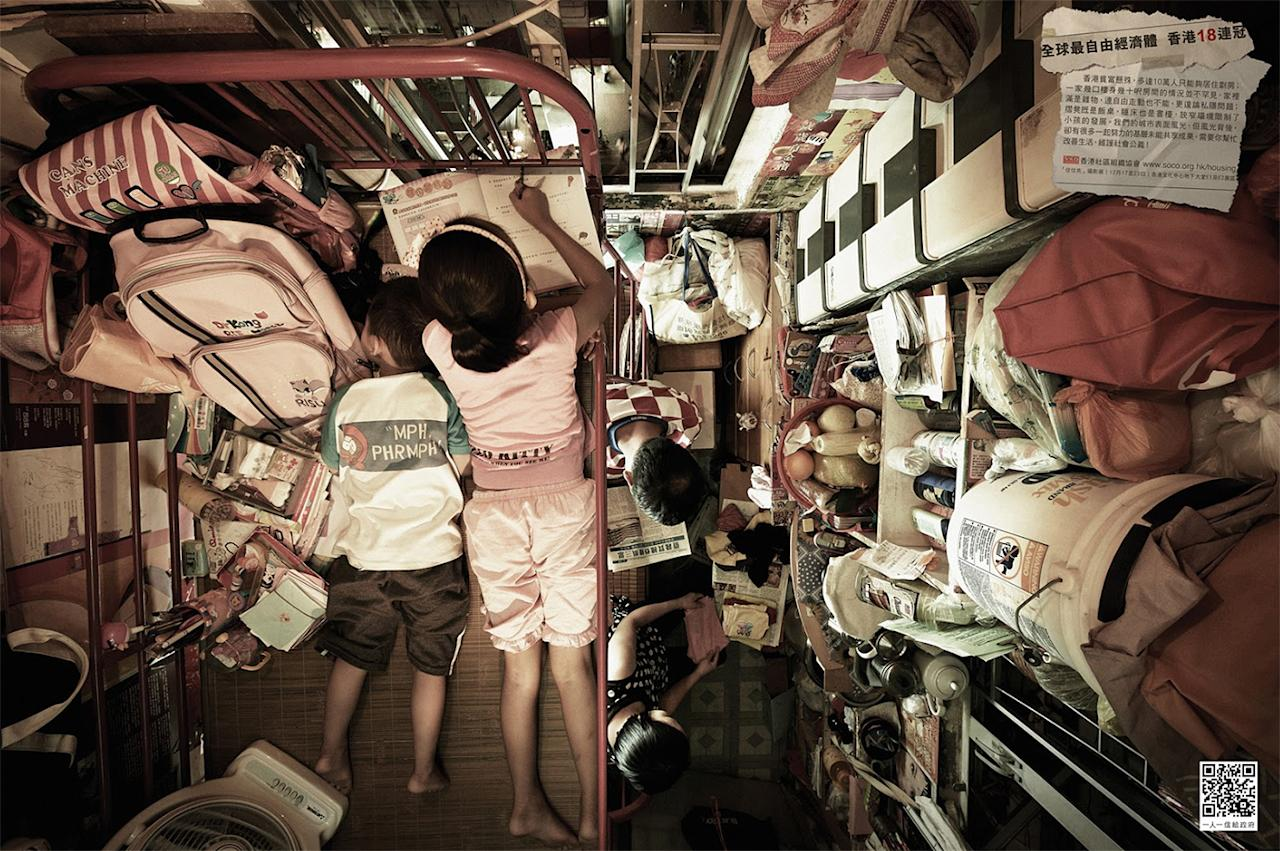These wide-angle photos are shot from overhead, highlighting the plight of the individuals and families who stack their belongings as high as the ceiling.