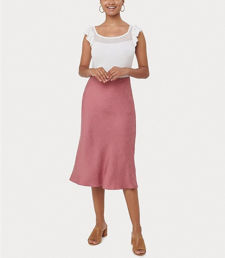<p>Dress up this <span>Loft Pull On Midi Skirt</span> ($70) with a cute tee and heels.</p>