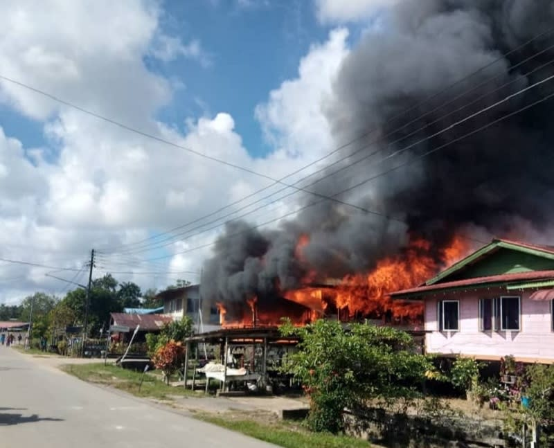 The fire at its height in Kampung Lintang, Balingian, this morning, May 12, 2021. — Picture courtesy of the Mukah Bomba station