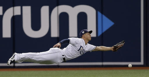 Tampa Bay Rays left fielder Rob Refsnyder dives for but can't get a single by Baltimore Orioles' Andrew Susac during the fifth inning of a baseball game Friday, May 25, 2018, in St. Petersburg, Fla. (AP Photo/Chris O'Meara)