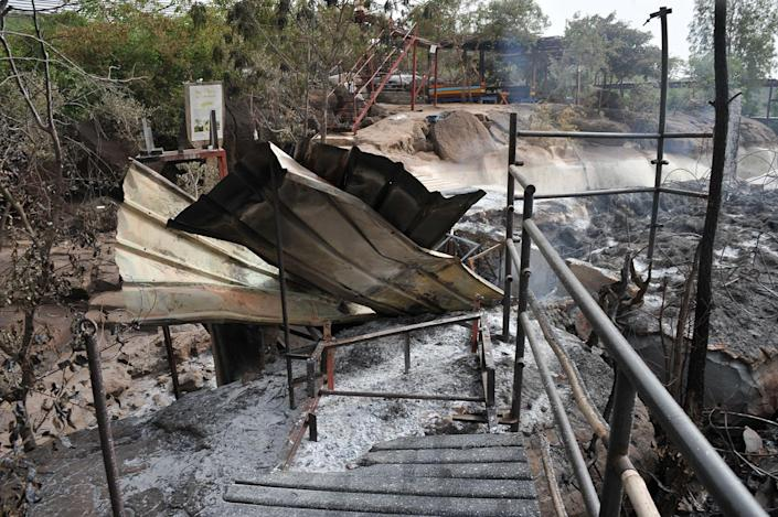 <p>Photo taken June 19, 2017 shows burned barracks inside the Kangaba tourist resort in Bamako on June 20, 2017, a day after suspected jihadists stormed the resort, briefly seizing more than 30 hostages and leaving at least two people dead. (Habibou Kouyate/AFP/Getty Images) </p>
