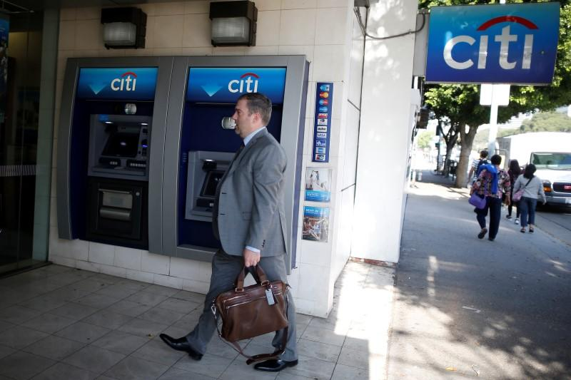 A man walks past a Citibank ATM in Los Angeles
