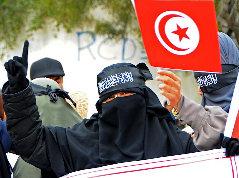 A Tunisian salafist woman demonstrates in front of the building of Tunisian national television in Tunis, Tunisia, Friday, March 9, 2012. Every Friday, bearded men in shin-length robes demonstrate in Tunisia's capital against perceived insults to Islam in a country once known for its aggressive secularism. (AP Photo/Hassene Dridi)