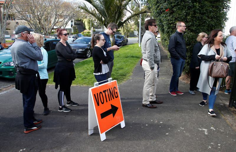 FILE PHOTO: Voters wait outside a polling station at the St Heliers Tennis Club during the general election in Auckland