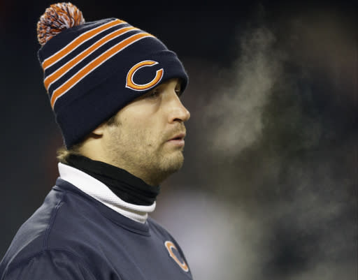 Injured Chicago Bears quarterback Jay Cutler walks around the field during team warmups before an NFL football game between the Bears and the Dallas Cowboys, Monday, Dec. 9, 2013, in Chicago. (AP Photo/Nam Y. Huh)