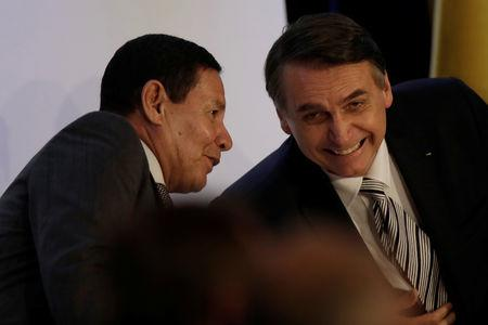 Brazil's President Jair Bolsonaro smiles with Vice President Hamilton Mourao during an inauguration ceremony of the new president of the Parliamentary Agricultural Front (FPA) in Brasilia, Brazil February 19, 2019. REUTERS/Ueslei Marcelino