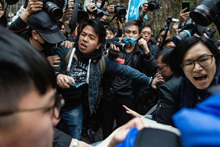 Ivan Lam (centre) has been convicted four times for pro-democracy protests or rallies against various government proposals