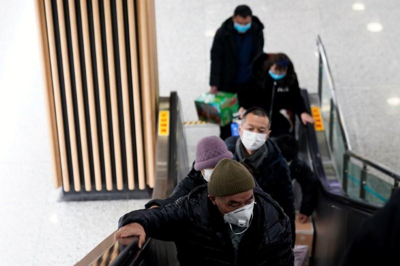 People wearing protective masks are seen at a subway station in Shanghai