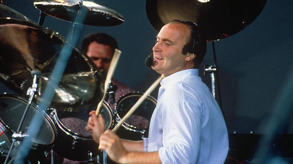 Mandatory Credit: Photo by Shutterstock (173244am)Phil CollinsNordoff Robbins Music Therapy Concert at Knebworth, Britain - 1990.