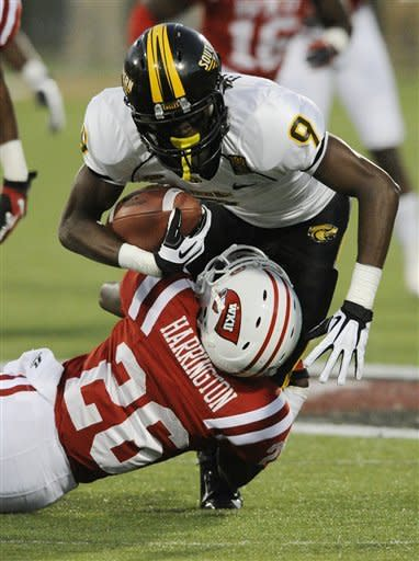 Southern Mississippi wide receiver Chris Briggs (9)runs over Western Kentucky defensive back Brett Harrington (26) in the first half of an NCAA college football game in Bowling Green, Ky., Saturday, Sept. 22, 2012. (AP Photo/Daily News, Joe Imel)
