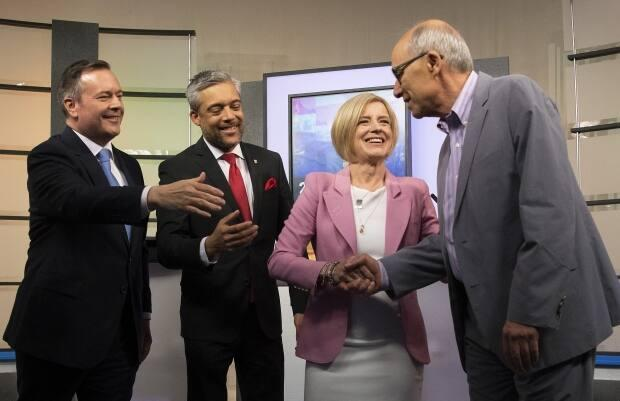 Alberta Liberal Party leader David Khan, 2nd from left, and Alberta Party leader Stephen Mandel, at right, greet their opponents at the 2019 Alberta Leaders Debate in Edmonton. Both Khan and Mandel stepped down from their parties' helms after failing to win any seats in the ensuing election.