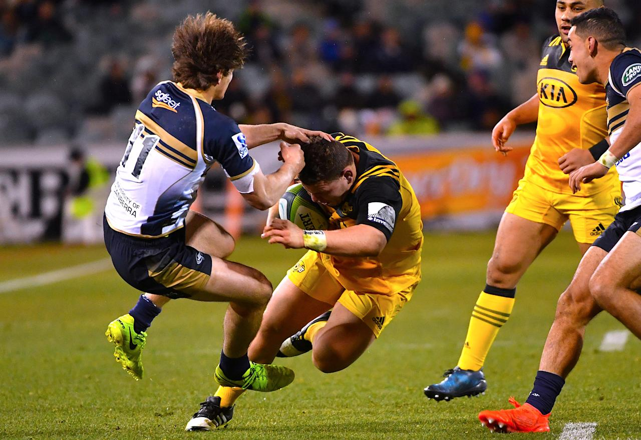 Rugby Union - Super Rugby - Wellington Hurricanes vs ACT Brumbies - Canberra, Australia - July 21, 2017 - Ricky Riccitelli of the Wellington Hurricanes fends off James Dargaville of the ACT Brumbies during their quarterfinal Super Rugby match.   AAP/Mick Tsikas/via REUTERS    ATTENTION EDITORS - THIS IMAGE WAS PROVIDED BY A THIRD PARTY. NO RESALES. NO ARCHIVE. AUSTRALIA OUT. NEW ZEALAND OUT.
