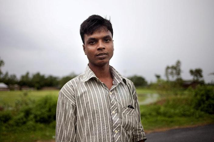Bangladeshi villager Shukkur Ali, 21, one of many victims of illegal organ trade, seen posing for a photo in the village of Kalai, some 300 km north-west of Dhaka (AFP Photo/Suvra Kanti Das)