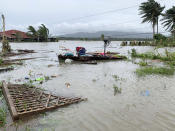 The remains of a house is surrounded by floods in Pola town on the island of Mindoro, central Philippines, Monday, Oct. 26, 2020. A fast-moving typhoon forced thousands of villagers to flee to safety in provinces south of the Philippine capital Monday, flooding rural villages and ripping off roofs, officials said. (AP Photo/Erik De Castro)