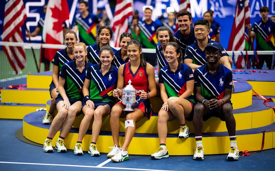 Raducanu celebrates with the US Open ball boys and girls - GETTY IMAGES
