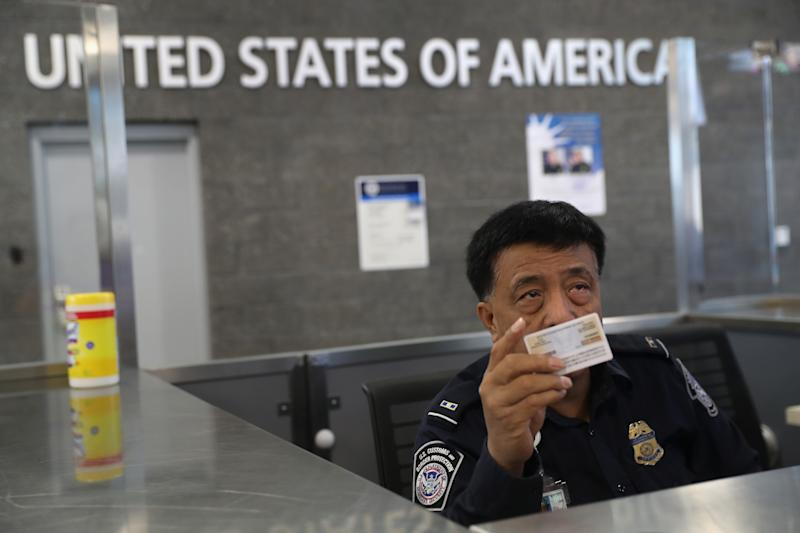 Customs And Border Protection Agents Work At San Ysidro Port Of Entry On U.S. Mexico Border