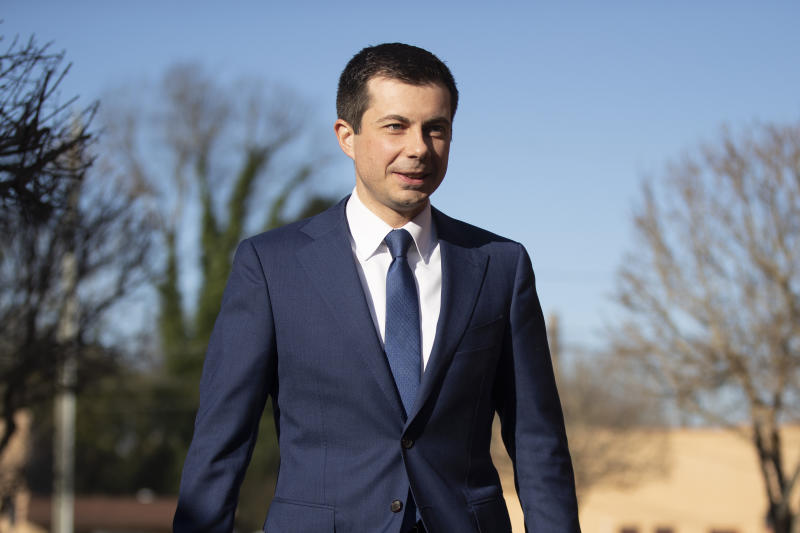 Democratic presidential candidate and former South Bend, Ind. Mayor Pete Buttigieg walks to speaks with members of the media, Sunday, March 1, 2020, in Plains, Ga. (AP Photo/Matt Rourke)