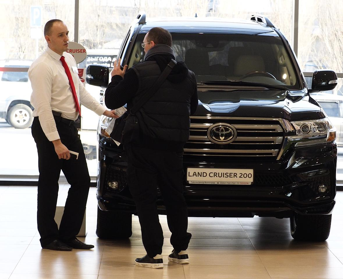 <p>While the basic salary is around the national average, car salesmen can make big money on commission if they can sell enough vehicles. (Dmitry Rogulin\TASS via Getty Images) </p>