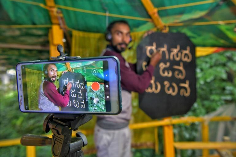 C.S. Satheesha teaches remotely from a treehouse in his back garden, where he can get better reception