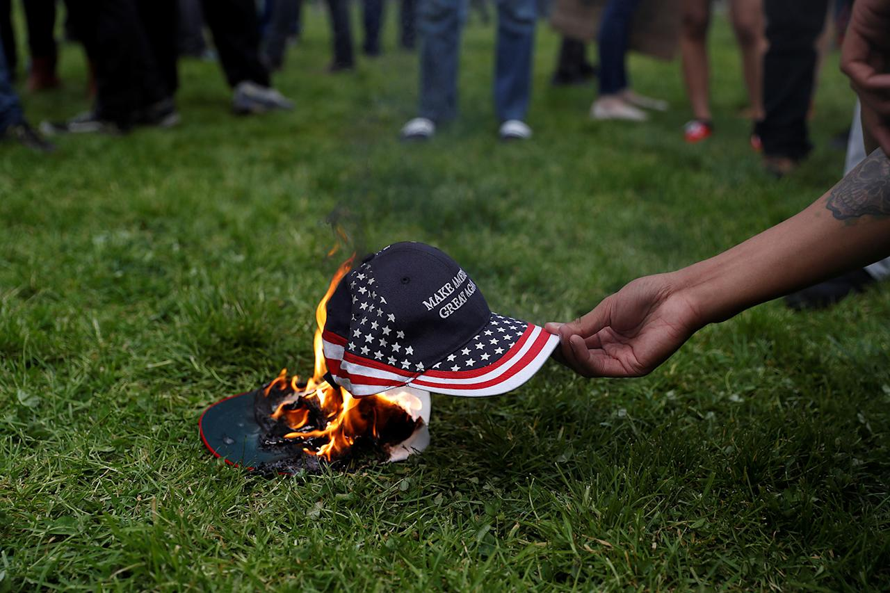 "<p>A demonstrator in opposition of U.S. President Donald Trump sets a hat on fire during a ""People 4 Trump"" rally in Berkeley, California March 4, 2017. (Photo: Stephen Lam/Reuters) </p>"