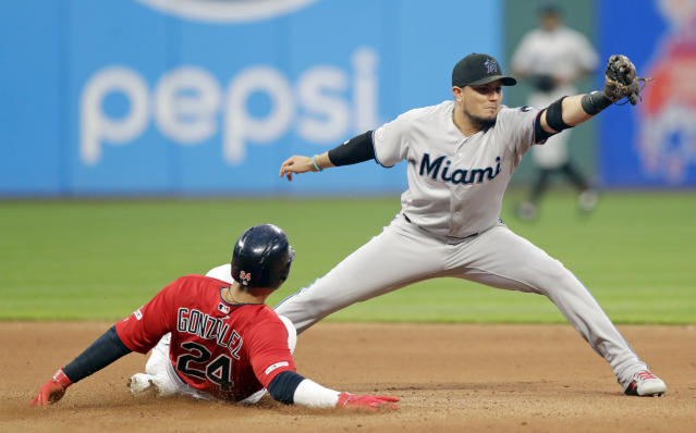 Cleveland Indians' Carlos Gonzalez is safe at second base as Miami Marlins' Miguel Rojas is late on the tag in the seventh inning of a baseball game, Tuesday, April 23, 2019, in Cleveland. Gonzalez was safe on an error by Starlin Castro. (AP Photo/Tony Dejak)